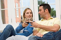 Close-up of a young couple toasting with glasses of wine