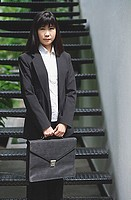 Businesswoman standing with briefcase