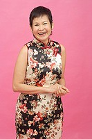 Mature woman in floral dress smiling