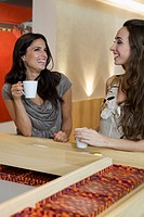 Women drinking coffee in cafe