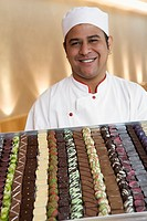 Baker displaying chocolates