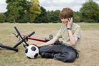 Teenage boy on cellphone in park