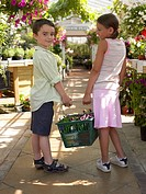 Children shopping at garden centre