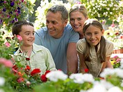 Smiling family in garden (thumbnail)