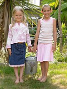 Sisters holding a watering can
