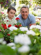Father and son near flowers