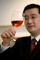 Man swirling wine in glass