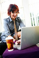 Businesswoman sitting and using a laptop