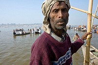 A boatman leads Pilgrims on boats to reach Sangam,  the meeting point of the Yamuna river and the Ganges river, the holiest place where to bath during...