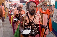 Nagababa sadhus begging food in the street of the Juna Akhara. A ceremonial taking place everyday at the ardh khumbh mela