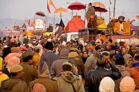 Pilgrims and sadhus during the procession toward the banks of the  banks of the Holy banks during the ardh khumbh mela. Big crowds