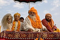 A 'Mahant'  ( the leader) from an Akhara, on top of a truck during the procession toward the sacred Ganges