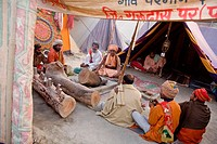 Nagababas sitting around a campfire in the late afternoon in the Juna akhara. During the Ardh Kumbh Mela 2007 in Prayag
