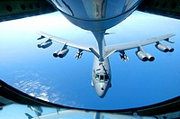 A KC-135 Stratotanker refuels a B-52 Stratofortress over the Indian Ocean. The two aircraft are from a forward deployed location supporting Operation ...