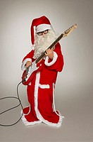 Young Santa playing guitar