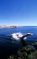 Person diving into the Baltic sea
