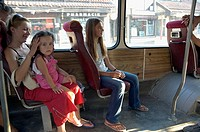 Woman and children on a bus in Pristina, Kosovo 2006