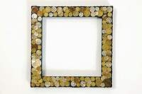 Picture frame with coins, close-up