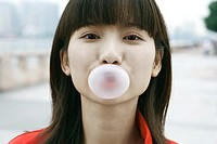 Young woman blowing bubble, close-up