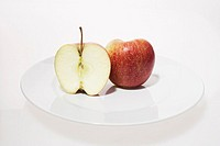 still life of cut apple on plate