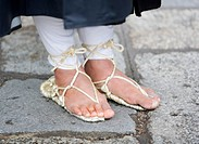 Japan, Kyoto, grass rope sandals, buddhist monk, low section, close-up