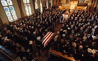 Armed Forces Honor Guard members bring the casket of former President Gerald R. Ford into the Grace Episcopal Church for his funeral service Jan. 3 in...