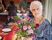 Senior woman holding bunch of flowers