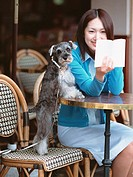 Woman reading book for dog