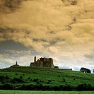Low angle view of palace on hill under cloudy sky, Rock Of Cashel, Republic of Ireland