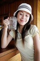 View of a young woman drinking water