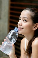 View of a young woman holding water bottle