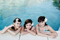 Portrait of three teenage girls in swimming pool