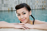 Portrait of a teenage girl in swimming pool (thumbnail)