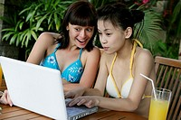View of two teenage girls working on a laptop
