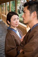 Japanese couple in Yukata at the corridor of the Japanese inn, side view, Japan