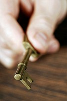 Close-up of a person's hand holding a key