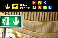 Close-up of an emergency exit sign at an airport, Madrid, Spain