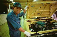Portrait of a male auto mechanic repairing a car, Zama, Kanagawa Prefecture, Japan
