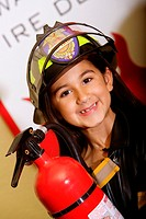 Close-up of a girl holding a fire extinguisher