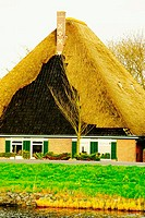 Lawn in front of a thatched roof house, Petten, Netherlands