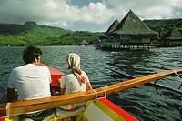 Rear view of a man and woman in a boat, Raiatea Island, Tahiti, Society Islands, French Polynesia