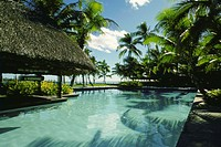 Swimming pool in front of stilt houses, Fiji