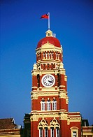 Low angle view of a clock tower of a government building, Supreme Court, Yangon, Myanmar