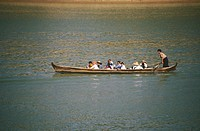 Group of people sitting in a rowboat, Ayeyarwady River, Myanmar