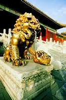 Statue of a lion in front of a building, Forbidden City, Beijing, China