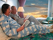 Older Couple Lounging Together on Bed