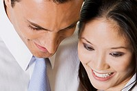 Close-up of a businessman and a businesswoman looking down