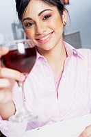 Portrait of a businesswoman holding a glass