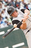 Baseball player hitting ball (thumbnail)
