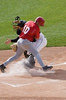 Baseball player charging home plate
